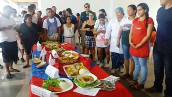 La exposición de los platos ganadores del concurso y los chefes de los respectivos restaurantes.